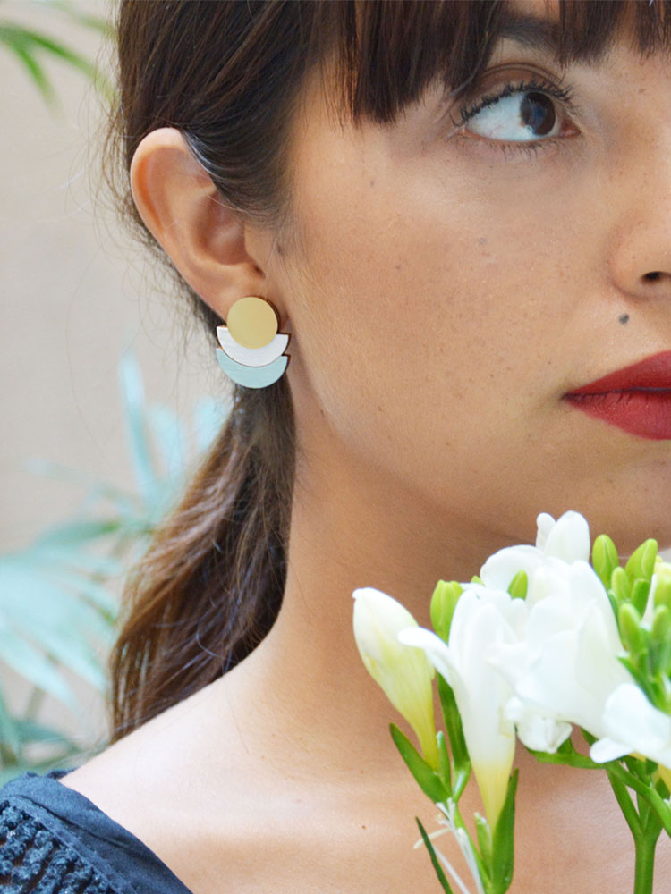 Delicate white stud earrings